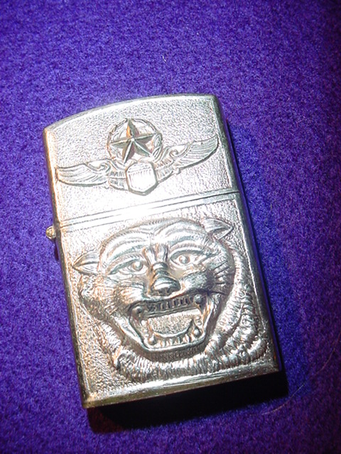 2dde16994d5 A really beautiful lighter with embossed tiger head and command pilot wing.  Looks like it was never used. Has the name and address of the Thai jeweler  on ...